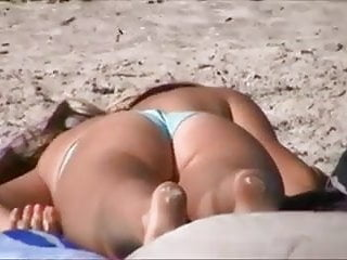 Teen caught playing with herself on the beach